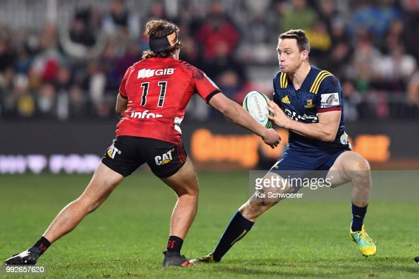 Ben Smith of the Highlanders charges forward during the round 18 Super Rugby match between the Crusaders and the Highlanders at AMI Stadium on July 6...