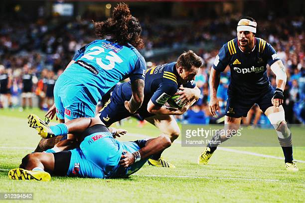 Ben Smith of the Highlanders dives over to score a try during the round one Super Rugby match between the Blues and the Highlanders at Eden Park on...
