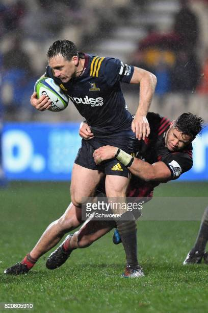 Ben Smith of the Highlanders is tackled by David Havili of the Crusaders during the Super Rugby Quarter Final match between the Crusaders and the...