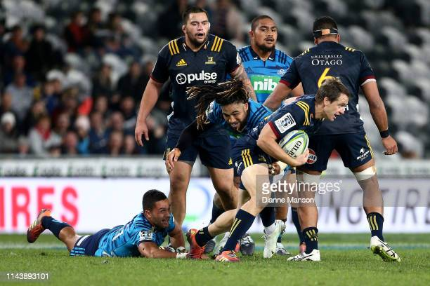 Ben Smith of the Highlanders is tackled by Ma'a Nonu of the Blues during the round 10 Super Rugby match between the Highlanders and the Blues at...