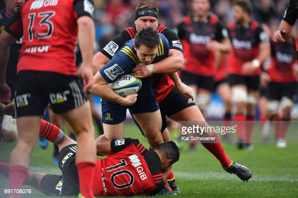 Ben Smith of the Highlanders is tackled during the round 15 Super Rugby match between the Crusaders and the Highlanders at AMI Stadium on June 3 2017...