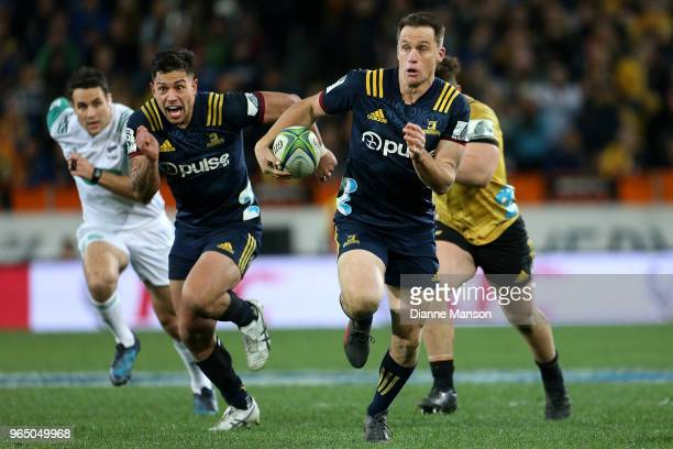 Ben Smith of the Highlanders makes a break during the round 16 Super Rugby match between the Highlanders and the Hurricanes at Forsyth Barr Stadium...