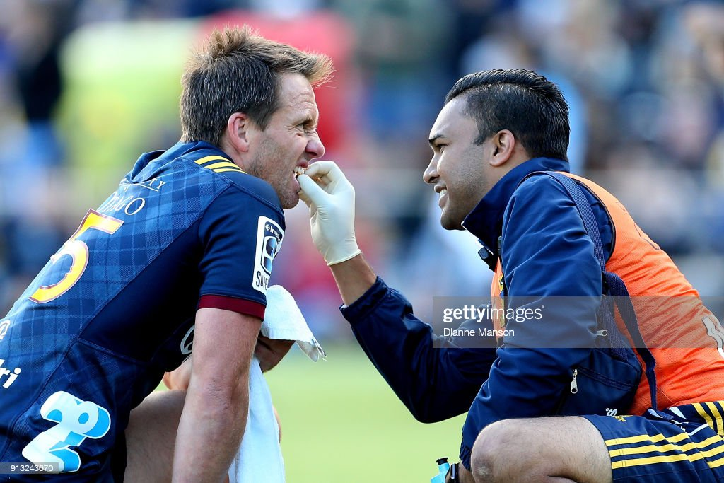 Ben Smith of the Highlanders receives treatment for his tooth during the Super Rugby pre-season match between the Highlanders and the Waratahs on February 2, 2018 in Queenstown, New Zealand.