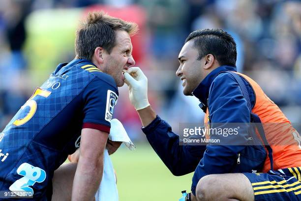 Ben Smith of the Highlanders receives treatment for his tooth during the Super Rugby preseason match between the Highlanders and the Waratahs on...