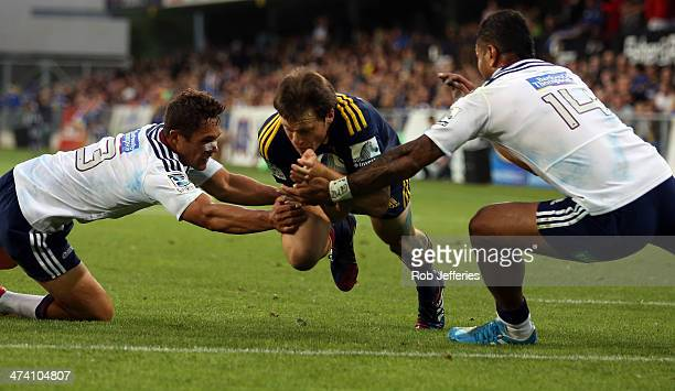 Ben Smith of the Highlanders scores a try during the round two Super Rugby match between the Highlanders and the Blues at Forsyth Barr Stadium on...