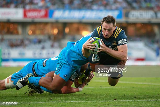 Ben Smith of the Highlanders scores the opening try during the round one Super Rugby match between the Blues and the Highlanders at Eden Park on...