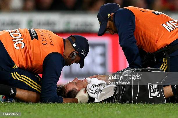 Ben Smith of the Highlanders seeks attention from the medics during the Round 12 Super Rugby match between the Highlanders and the Chiefs on May 04...