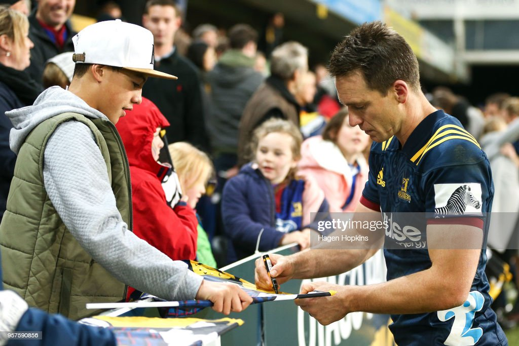 Ben Smith of the Highlanders signs a flag for a fan during the round 12 Super Rugby match between the Highlanders and the Lions at Forsyth Barr Stadium on May 12, 2018 in Dunedin, New Zealand.