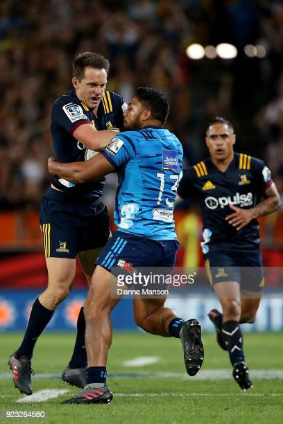 Ben Smith of the Highlanders tries to break through the tackle of George Moala of the Blues during the round two Super Rugby match between the...