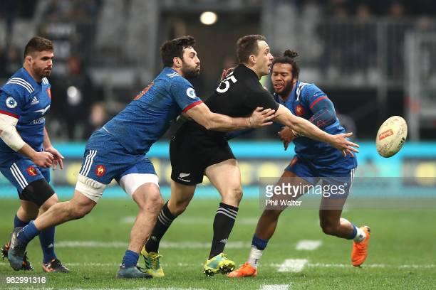Ben Smith of the New Zealand All Blacks is tackled during the International Test match between the New Zealand All Blacks and France at Forsyth Barr...