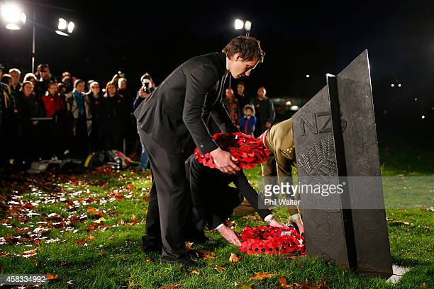 Ben Smith of the New Zealand All Blacks places a wreath at the New Zealand Memorial at Hyde Park corner November 3 2014 in London England Members of...