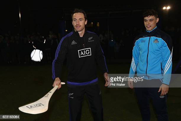 Ben Smith of the New Zealand All Blacks tries the Irish sport of Hurling and gets advice from Eoghan O'Donnell of the Dublin Hurling Team at...