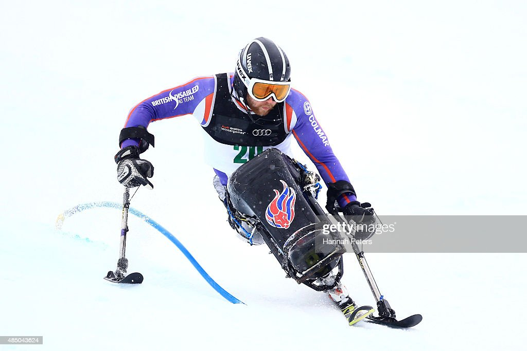 Ben Sneesby of Great Britain competes in the Men Slalom Sitting LW-12-1 during the IPC Alpine Adaptive Slalom Southern Hemisphere Cup during the Winter Games NZ at Coronet Peak on August 24, 2015 in Queenstown, New Zealand.