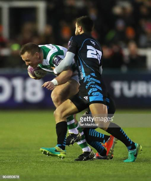 Ben Sowrey of Newcastle Falcons is tackled by Evgeny Nepeivoda of EniseiSTM during the European Rugby Challenge Cup match between Newcastle Falcons...