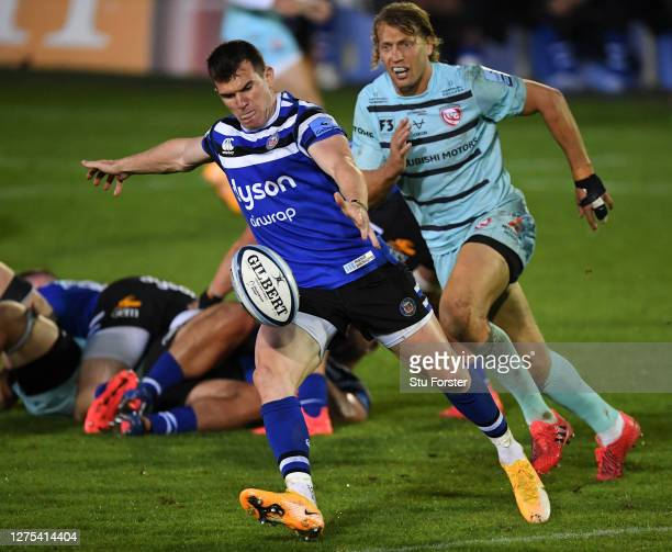 Ben Spencer of Bath Rugby clears the ball as he is put under pressure by Billy Twelvetrees of Gloucester Rugby during the Gallagher Premiership Rugby...