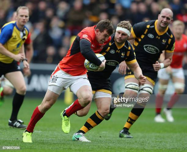 Ben Spencer of Saracens breaks clear to score the first try during the Aviva Premiership match between Wasps and Saracens at The Ricoh Arena on May 6...