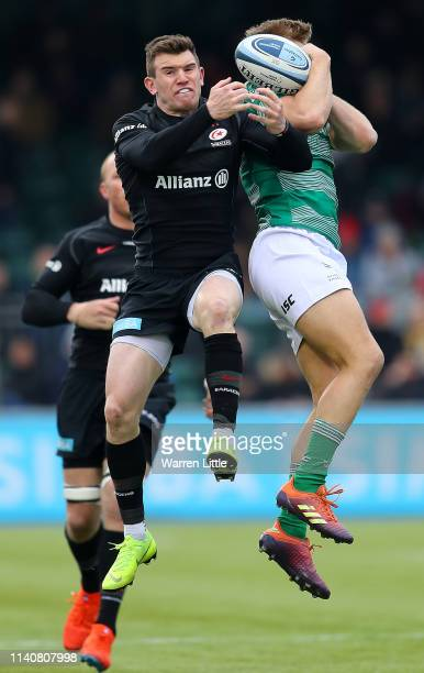 Ben Spencer of Saracens jumps for the ball against Chris Harris of Newcastle Falcons during the Gallagher Premiership Rugby match between Saracens...