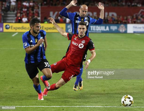 TORONTO ON SEPTEMBER 20 Ben Spenxer falls as he tries to get past Montreal Impact defender Deian Boldor as Toronto FC fall to the Montreal Impact 53...