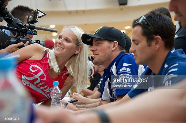 Ben Spies of the US and Yamaha Factory Racing poses with a fan during the preevent QA and autograph session in Vankovka Mall in Brno during the...