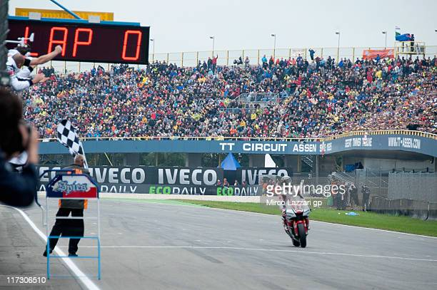 Ben Spies of USA and Yamaha Factory Racing cuts the finish line and celebrates the victory at the end of the MotoGP race of MotoGP of Netherlands at...