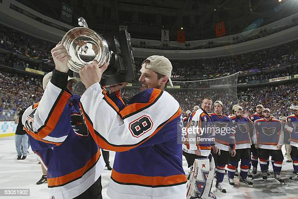 Ben Stafford and Dennis Seidenberg of the Philadelphia Phantoms with the Calder Cup after the Phantoms defeated the Chicago Wolves 5-2 to sweep the...