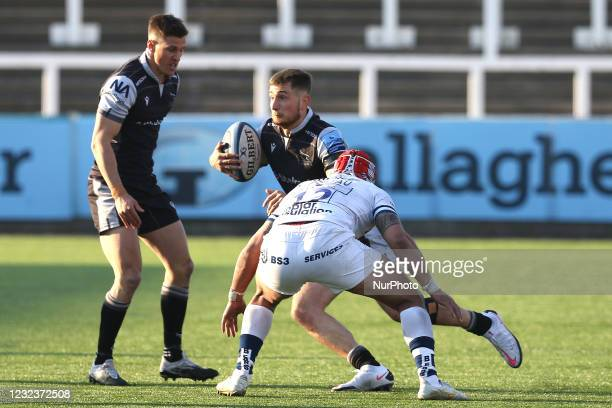 Ben Stevenson of Newcastle Falcons is challenged by Siale Piutau of Bristol Bears during the Gallagher Premiership match between Newcastle Falcons...