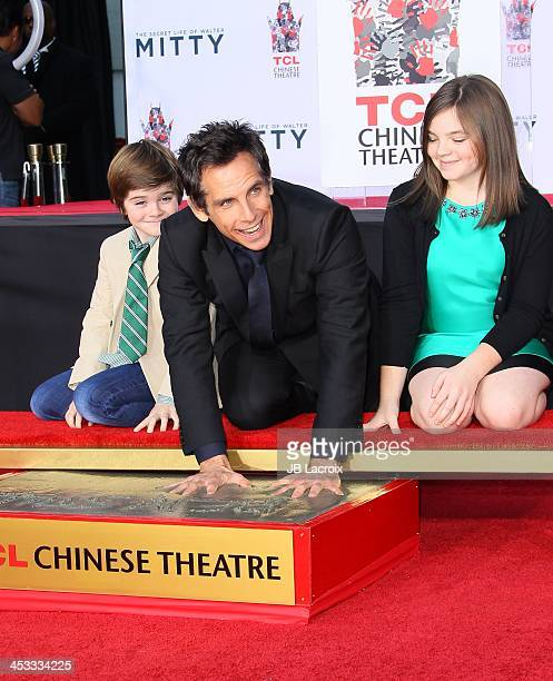 Ben Stiller Christine Taylor Quinlin Stiller and Ella Stiller pose as he is honored with a hand and footprint ceremony at TCL Chinese Theatre on...
