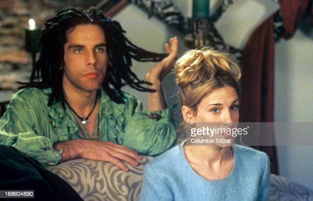 Ben Stiller kneeling behind Sarah Jessica Parker as he pulls at some of the dreadlocks on his head in a scene from the film 'If Lucy Fell' 1996