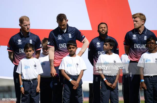 Ben Stokes Alex Hales Adil Rashid and David Willey of England line up for the national anthems before the ICC Champions Trophy match between England...