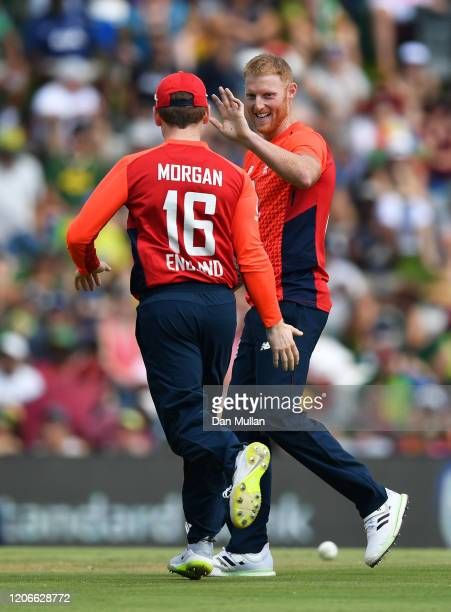 Ben Stokes and Eoin Morgan of England celebrate after dismissing Quinton de Kock of South Africa during the Third T20 International match between...