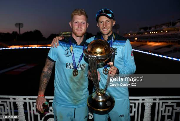 Ben Stokes and Joe Root of England celebrate in the dressing rooms after winning the Final of the ICC Cricket World Cup 2019 between England and New...