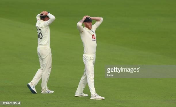 Ben Stokes and Joe Root react during Day Three of the 1st #RaiseTheBat Test Match between England and Pakistan at Emirates Old Trafford on August 07...