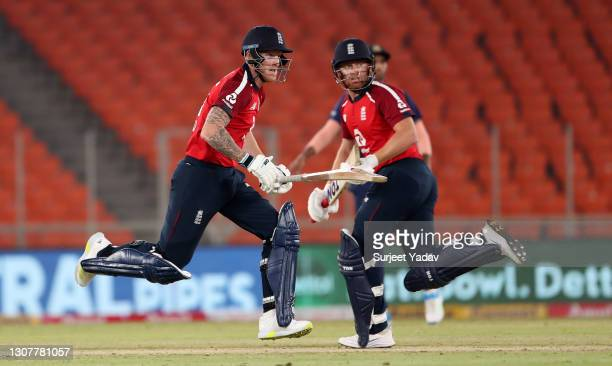 Ben Stokes and Jonathan Bairstow of England run between the wickets during the 4th T20 International between India and England at Narendra Modi...