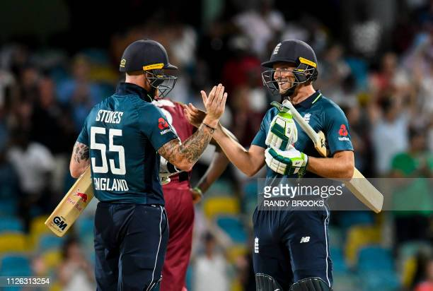 Ben Stokes and Jos Buttler of England celebrate winning the 1st ODI between West Indies and England at Kensington Oval Bridgetown Barbados on...