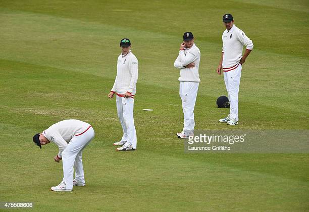 Ben Stokes, Joe Root, Ian Bell and Alastair Cook of England look on in dismay as the New Zealand tail pile on the runs during day four of the 2nd...