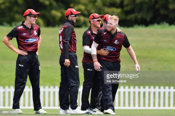 Ben Stokes of Canterbury is congratulated by team mates after dismissing Anton Devcich during the One Day Ford Trophy Cup match between Canterbury...