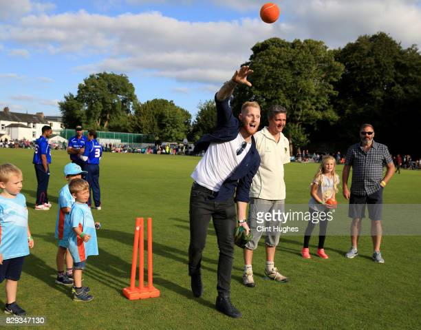 Ben Stokes of Durham and England coaches some children during the PCA England Masters Day at Cockermouth Cricket Club on August 10, 2017 in...