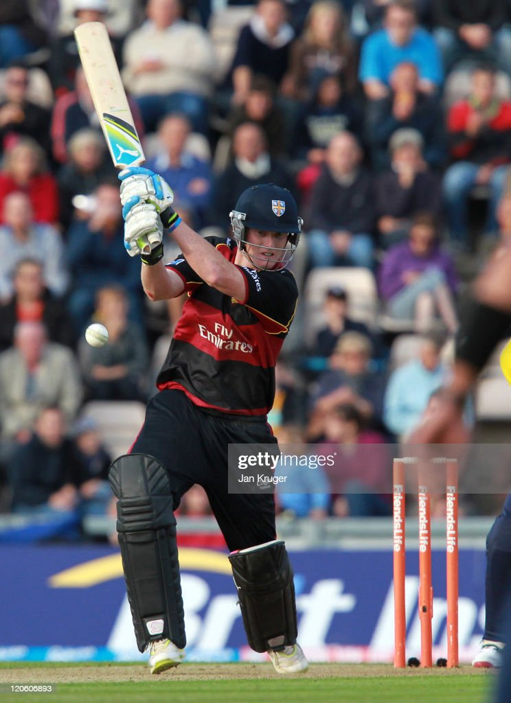 ben stokes of durham plays a cover drive with michael bates of