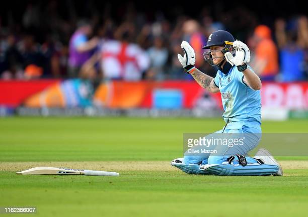 Ben Stokes of England apologises to New Zealand as the fielded ball hits his bat and runs away for four runs during the Final of the ICC Cricket...