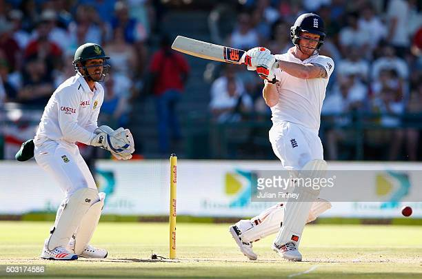 Ben Stokes of England bats as Quinton de Kock of South Africa keeps wicket during day one of the 2nd Test at Newlands Stadium on January 2 2016 in...