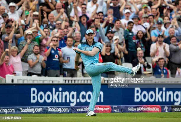 Ben Stokes of England celebrates after taking a stunning catch to dismiss Andile Phehlukwayo of South Africa during the Group Stage match of the ICC...