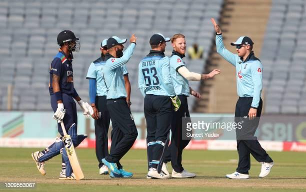 Ben Stokes of England celebrates after taking the wicket of Hardik Pandya of India with team mates Chris Jordan, Moeen Ali, Jos Buttler and Jason Roy...