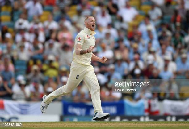 Ben Stokes of England celebrates after taking the wicket of Kraigg Braithwaite of West Indies during Day One of the First Test match between England...
