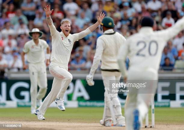 Ben Stokes of England celebrates after taking the wicket of Usman Khawaja of Australia during day three of the 1st Specsavers Ashes Test between...