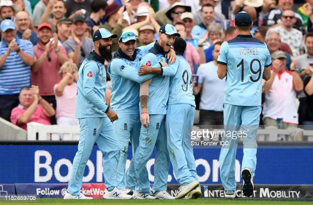 Ben Stokes of England celebrates as he takes a catch to dismiss Andile Phehlukwayo of South Africa during the Group Stage match of the ICC Cricket...