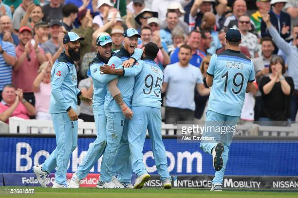 Ben Stokes of England celebrates taking the catch of Andile Phehlukwayo of South Africa with Moeen Ali Jason Roy and Adil Rashid of England during...