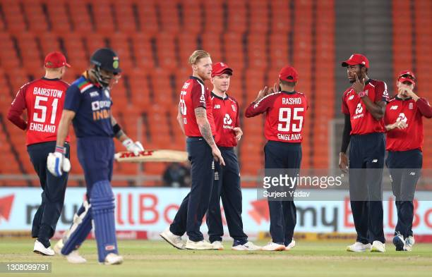 Ben Stokes of England celebrates the wicket of Rohit Sharma with team mates during the 5th T20 International between India and England at Narendra...