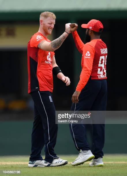 Ben Stokes of England celebrates with Adil Rashid after dismissing Shehan Madushanka of Sri Lanka Cricket Board XI during the tour match between Sri...