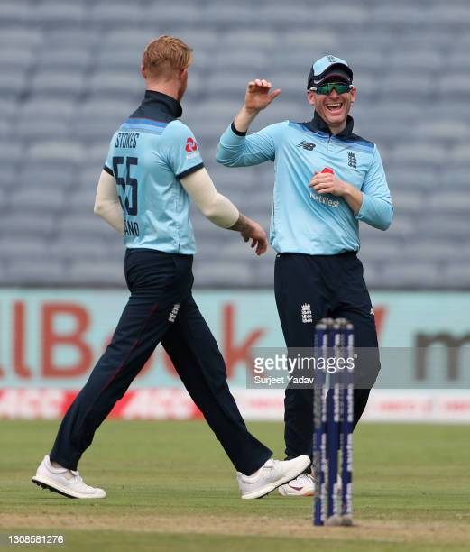 Ben Stokes of England celebrates with captain Eoin Morgan after dismissing Rohit Sharma of India during 1st One Day International between India and...