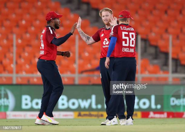 Ben Stokes of England celebrates with Chris Jordan and Sam Curran after dismissing KL Rahul of India during the 4th T20 International between India...